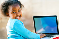 Afican child learning on computer Royalty Free Stock Photography