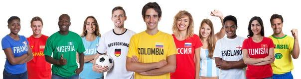 Aficionado al fútbol de Colombia con las fans de otros países fotos de archivo libres de regalías