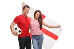 Aficionados al fútbol con una bandera inglesa Fotografía de archivo libre de regalías
