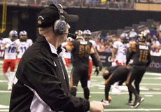 AFL Arizona Rattlers coach Kevin Guy. Watches as his team takes the field. The Rattlers won their third consecutive ArenaBowl Championship Royalty Free Stock Photo
