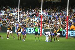 Afl football. Australian rules football, Western bulldogs versus Richmond tigers, played on the April 20 2008 game ends in draw. Jason Arkermanis  injured with Stock Image