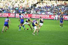 AFL football. Australian rules football, Western bulldogs versus Richmond tigers, played on the April 20 2008 game ends in draw. Players go for the ball Royalty Free Stock Photo