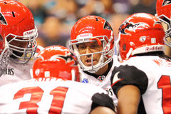 AFL: MAR 12 Jacksonville Sharks at Arizona Rattlers. 12 March 2011: Jacksonville Sharks Aaron Garcia (center) calls a play in the huddle during Arena Football Royalty Free Stock Image