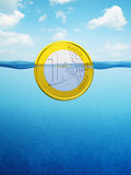 Afloat euro coin Stock Photo