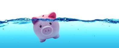 Afogando o banco Piggy Fotografia de Stock