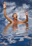 Afogar. Scared man in water with reflex Royalty Free Stock Photography