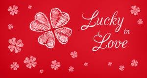Afortunado en bandera roja del saludo del amor Fotos de archivo