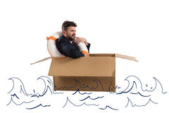 Afraid businessman with cardboard in the ocean Royalty Free Stock Photo