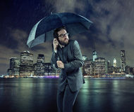 Afraid businessman in the rain Royalty Free Stock Image