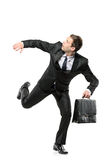 An afraid businessman running away stock image