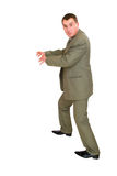 Afraid businessman stealing. To catch something isolated over white Royalty Free Stock Image