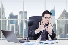 Afraid businessperon working at workplace Stock Images
