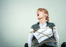 Afraid businesswoman bound by contract terms. Stock Images