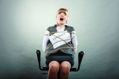 Afraid businesswoman bound by contract terms. Stock Image
