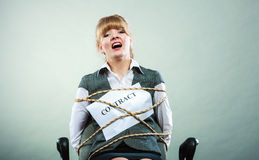 Afraid businesswoman bound by contract terms. Royalty Free Stock Images