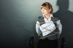 Afraid businesswoman bound by contract terms. Royalty Free Stock Photography