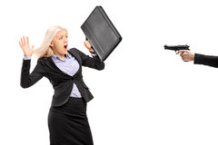 Afraid businesswoman from a gun Royalty Free Stock Image