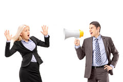 Afraid businesswoman and her manager shouting with a speakerphone royalty free stock photo