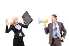 An afraid businesswoman and her manager shouting with a speakerphone royalty free stock images