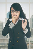 Afraid businesswoman standing in office Stock Images