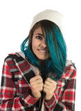 Afraid and cold hipster girl. On white background. Pierced, turquoise haired and dressing up a plaid shirt Stock Image