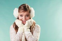 Afraid cute pretty woman girl in earmuffs. Stock Image