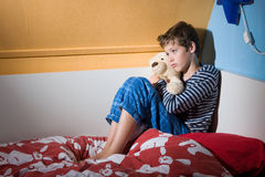 Afraid and depressed young boy Stock Photo