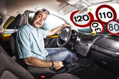 Afraid driver and speed limit Royalty Free Stock Photos