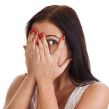 Afraid frightened woman peeking through her fingers. Stock Images
