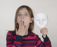 Afraid girl with mask. Afraid little girl with plaster mask Stock Photography