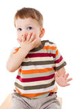 Afraid little boy with covered his mouth Stock Photos