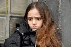 Afraid looking girl Stock Photo