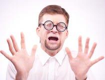 Afraid man in glasses Stock Image