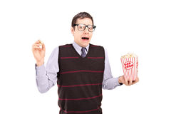 Afraid man holding a popcorn box Stock Images