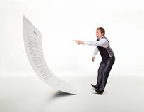 Afraid man points to the document Royalty Free Stock Photography