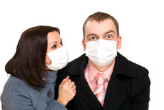 Afraid man and woman dressings mask Stock Image