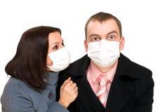 Afraid man and woman dressings mask Stock Image