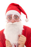 Afraid Santa Claus with goggles, concept protect and preserve th Royalty Free Stock Image