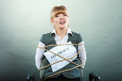 Afraid scared woman bound by contract terms. Royalty Free Stock Image