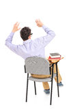 An afraid student sitting on a chair Stock Photo