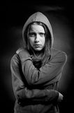 Afraid teen girl in hood Stock Photography