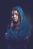 Afraid teen girl in hood. Afraid, sad teen girl in hood Royalty Free Stock Photography