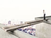 Afraid to fail. Businessman looking improvide bridge and he is thinking what to do royalty free stock photo