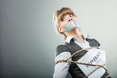 Afraid woman bound by contract with taped mouth. Royalty Free Stock Photo