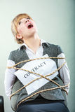 Afraid woman bound by contract tied to chair. Stock Images