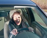Afraid woman in the car Royalty Free Stock Images