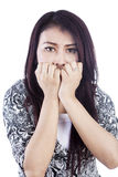 Afraid woman isolated over white Royalty Free Stock Image