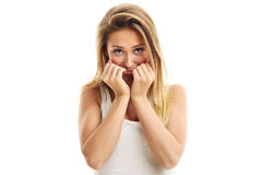 Afraid woman looking at camera  on a white background Stock Image