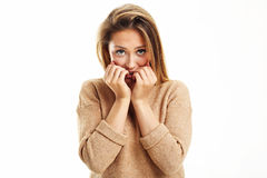 Afraid woman looking at camera  on a white background Stock Photos