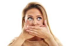 Afraid woman looking at camera  on a white background Royalty Free Stock Photos